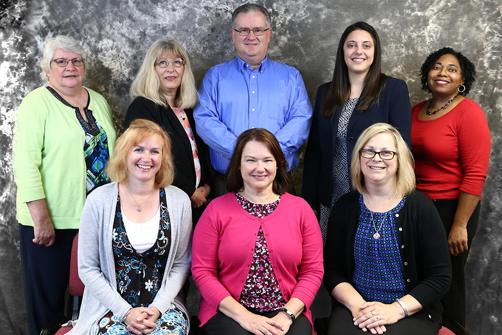 Pictured left to right - Back row: Ann Watts, Darlene Eisenhuth, Jeff Bingaman, Lauren E. Hokamp, and Theresa Hunter Front row: Christine Sims, Andra Haverstock, and Kelly Cox